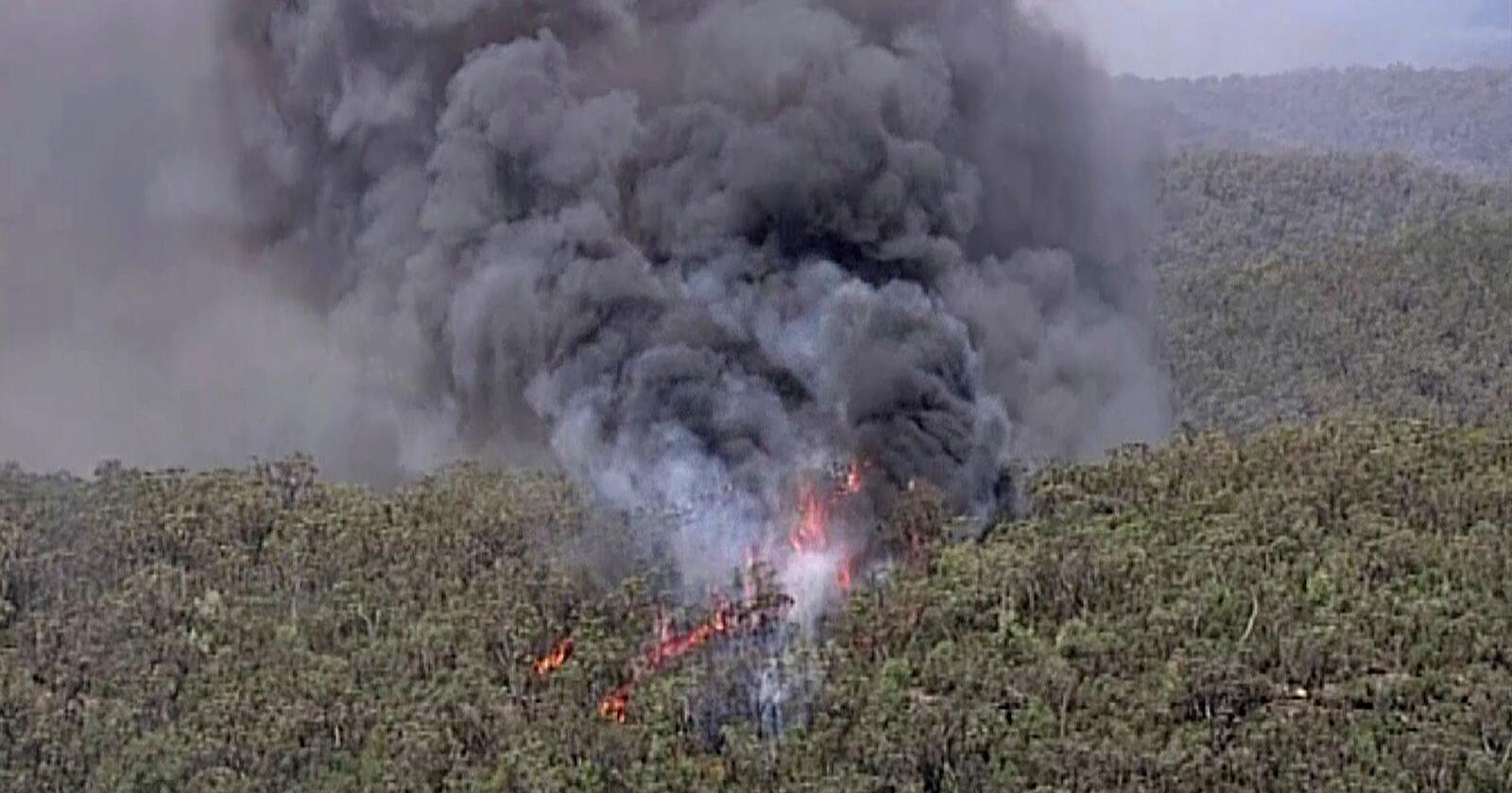 Brannen i Gospers Mountain har nå herjet i mer enn måned og har utviklet seg til det som er omtalt som en «megabrann». Hele den australske delstaten New South Wales er kraftig preget av de mange brannene som herjer i skogene. Foto: Australia Pool/ AP/ NTB scanpix