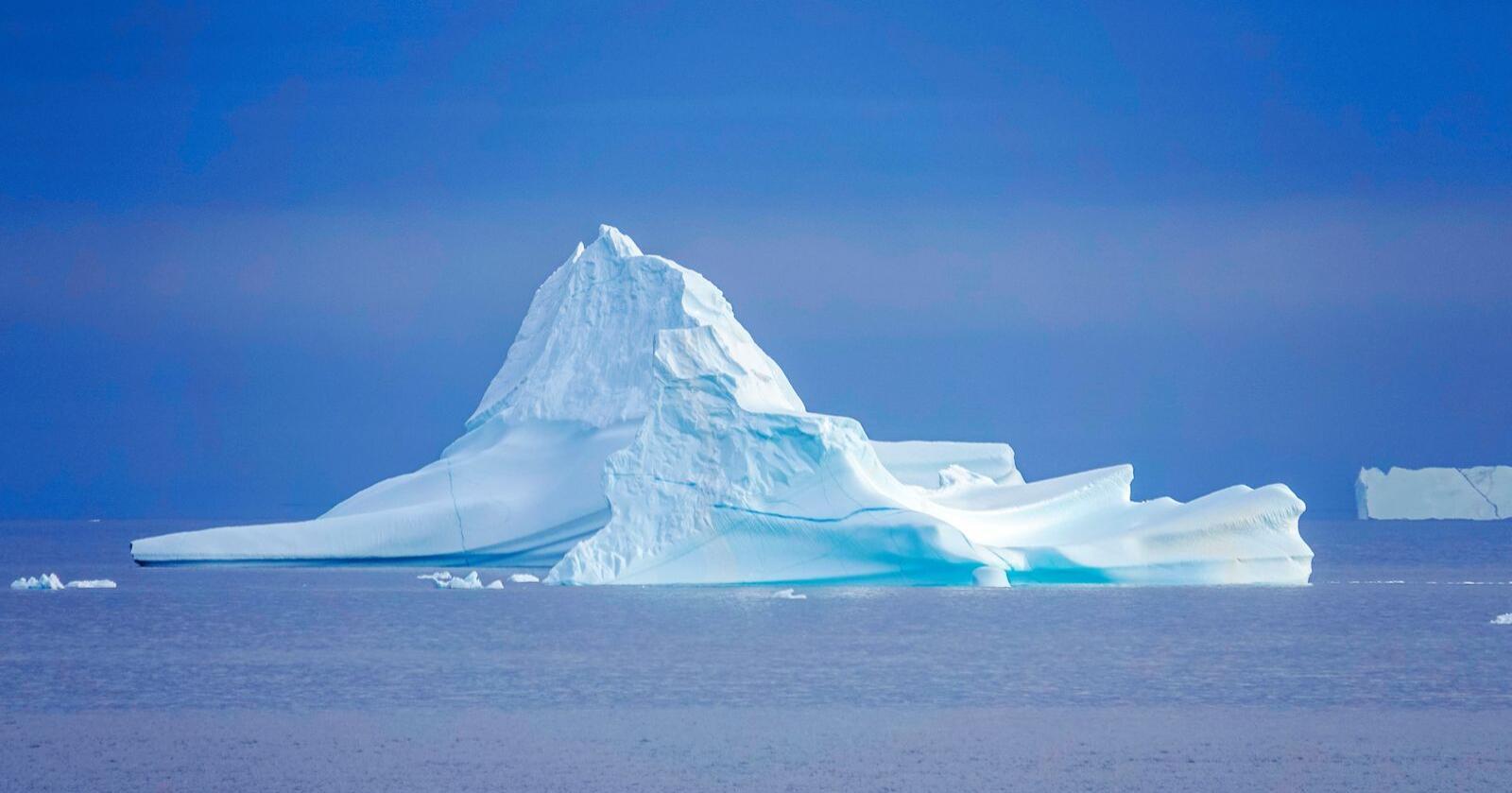 Klimaendringer: Isen som dekker Grønland smelter i rekordfart, og isfjell løsner fra innlandsisen. Foto: Heiko Junge / NTB scanpix