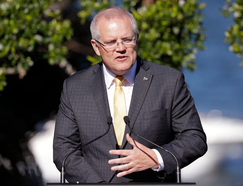 In this Oct. 9, 2019, photo, Australian Prime Minister Scott Morrison speaks the media in Sydney. Morrison said Thursday, Oct. 10, 2019, he had been in contact with the Turkish and U.S. governments overnight but admitted to being worried that Turkey's military incursion in northern Syria could galvanize a resurgence of the Islamic State group. (AP Photo/Rick Rycroft)