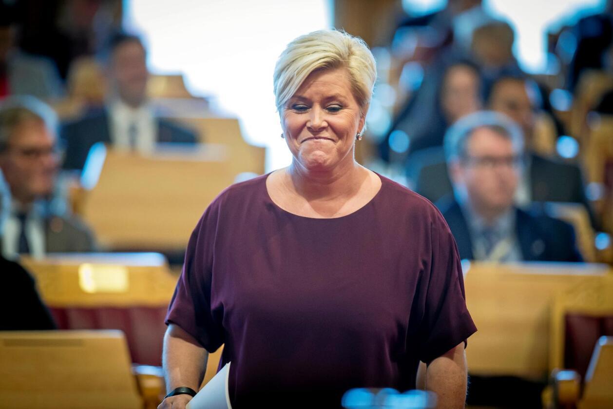 Siv Jensen inntok Stortingets talerstol torsdag formiddag for å legge fram neste års statsbudsjett. Foto: Heiko Junge / NTB scanpix