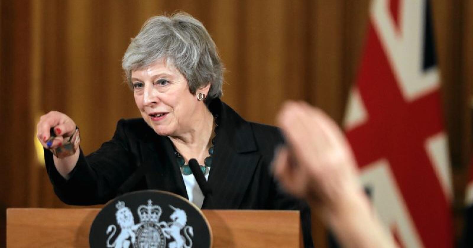 Storbritannias statsminister Theresa May kjemper hardt for å redde et utkast til en utmeldingsavtale med EU, som møter motstand både fra opposisjonen i Underhuset og Mays eget parti. Foto: AP / NTB scanpix.
