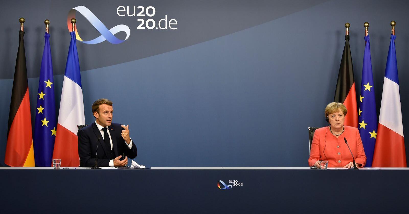 Korona: Tysklands Rikskanseler Angela Merkel og den franske presidenten Emmanuel Macron la fram en korona-krisepakke tirsdag 21. juli. Foto: John Thys / AP / NTB scanpix