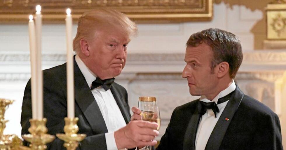 Skåler ikke lenger: President Donald Trump mener fransk vin er dårligere enn amerikansk, og truer president Emmanuel Macron med høyere toll på fransk vin til USA. Foto: AP Photo/Susan Walsh, NTB scanpix